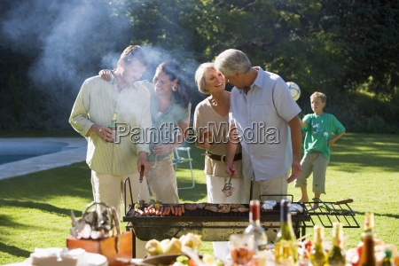 three generation family having barbecue in