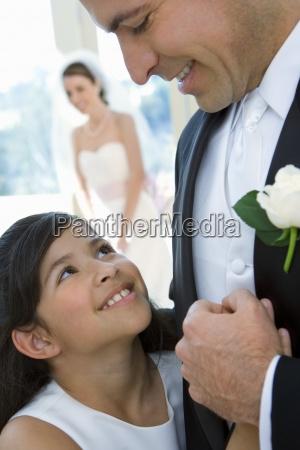 bride and groom posing at wedding