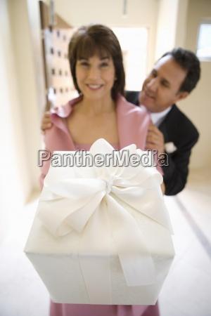 senior couple in formalwear standing in
