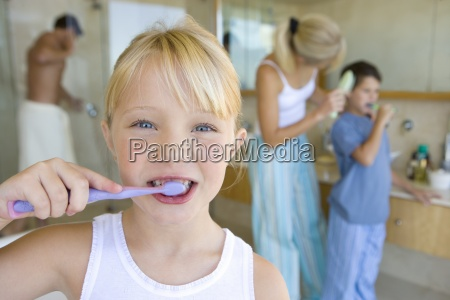 girl 6 8 brushing her teeth