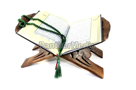 quran stand with open koran and