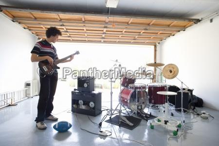 teenage boy 16 18 playing electric