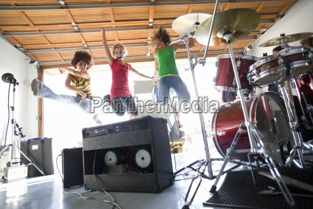 three teenage girls 16 18 jumping