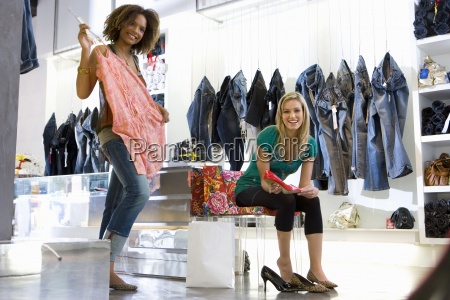 two young women shopping in clothes
