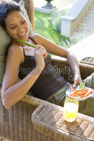 young woman with plate of vegetable