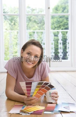 young woman on floor with mug