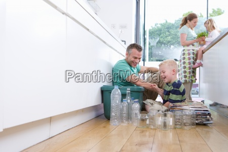 family of four in kitchen father