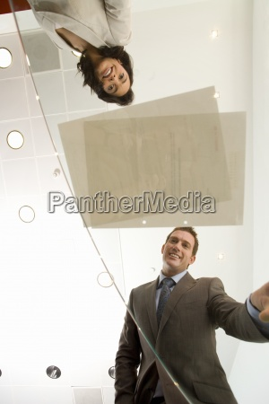 businessman and woman looking at paperwork