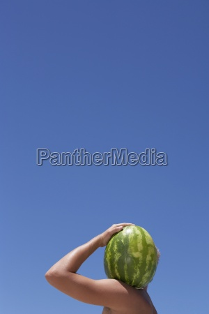 man carrying watermelon on shoulder face