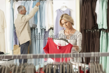 mature couple shopping in clothes shop