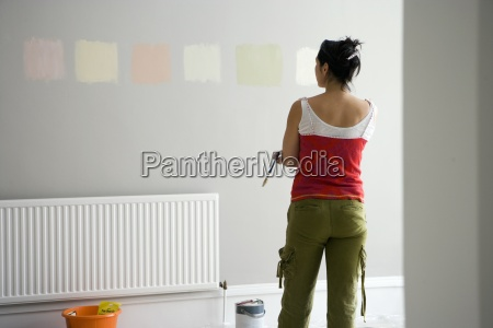 woman looking at various paint colours