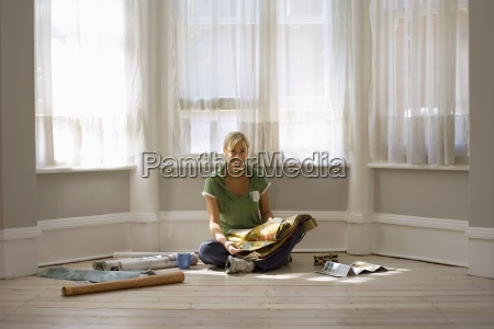 woman decorating at home sitting on