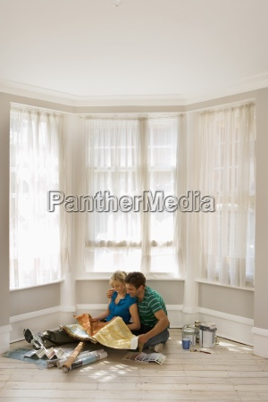 couple decorating at home sitting on
