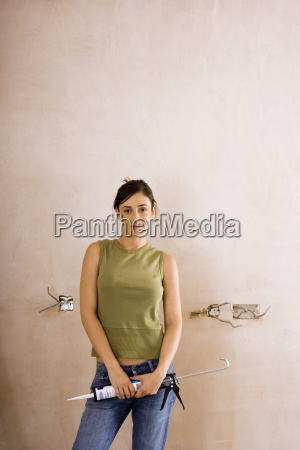 woman doing diy at home holding