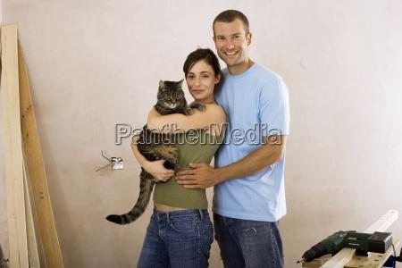 couple doing diy at home woman