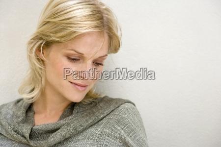 blonde woman thinking close up portrait