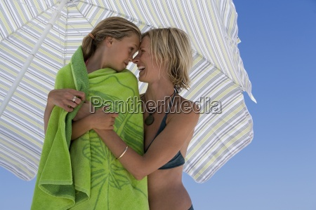mother embracing daughter 9 11 wrapped