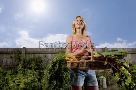 woman in organic garden holding basket