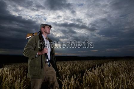 hunter holding rifle over shoulder in