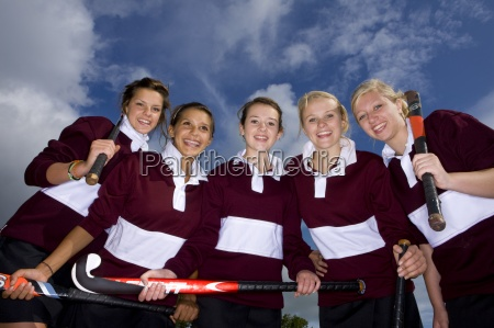 portrait of smiling teenage girls holding