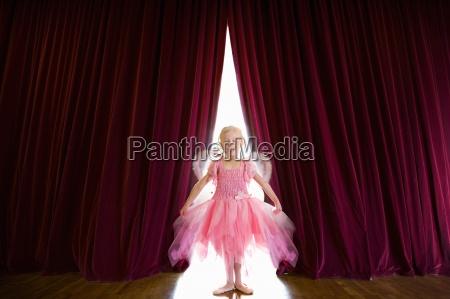 ballerina posing on stage