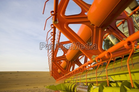 close up of combine in wheat