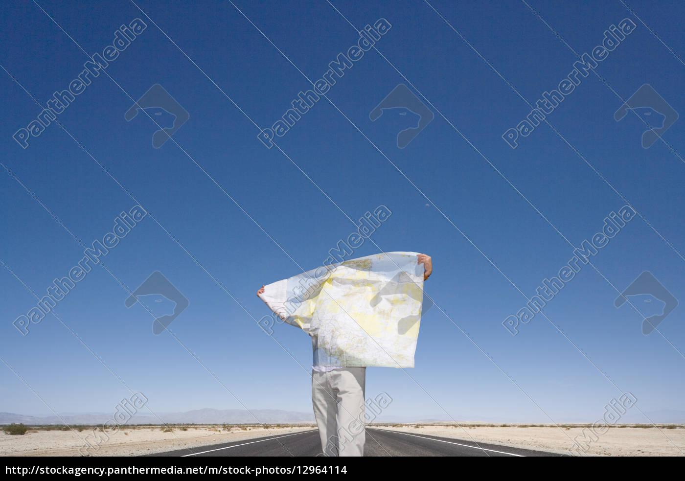 man, looking, at, map - 12964114