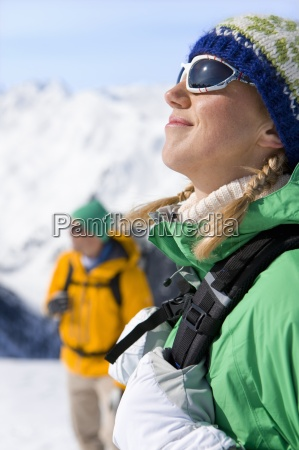 happy woman with backpack enjoying sunshine