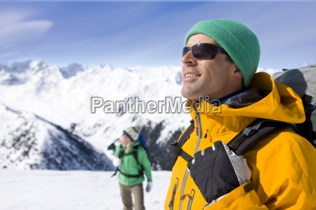 couple with backpacks enjoying sunshine on