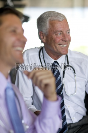 doctor with stethoscope talking to co