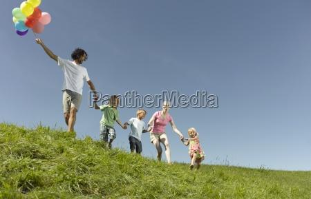 a family walking through the grass
