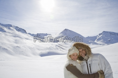 portrait of young couple in mountains