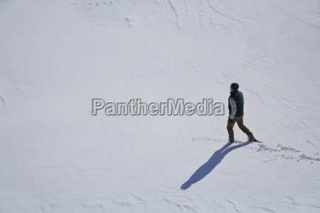 mid adult man walking in snow