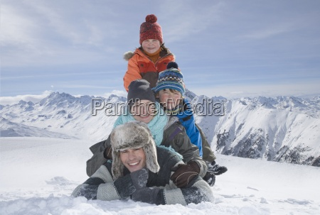 portrait of young family in mountains