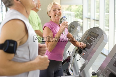 mature woman on treadmill with water
