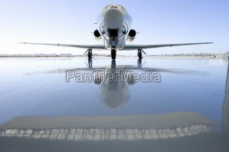 aeroplane on runway reflection on ground