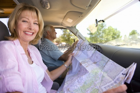 mature woman with map in motor