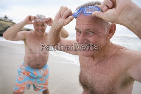 mature man and friend in swimming