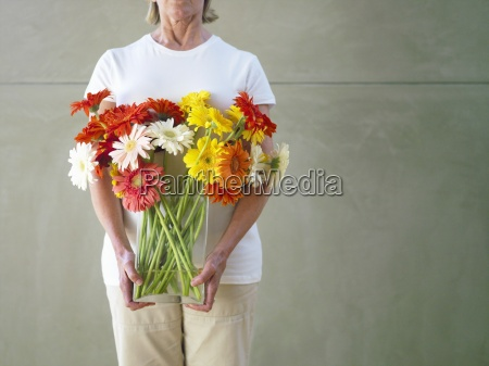 woman with vase of flowers mid