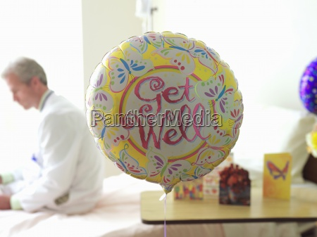 get well balloon in hospital doctor