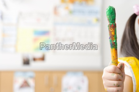 girl 3 5 with paintbrush at