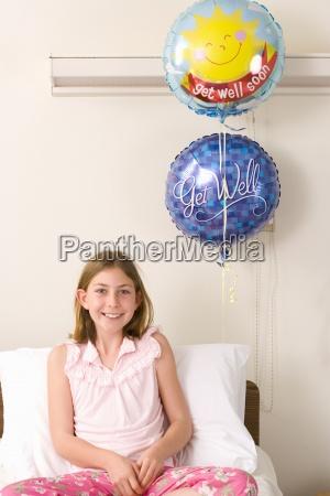 girl 10 12 in hospital bed