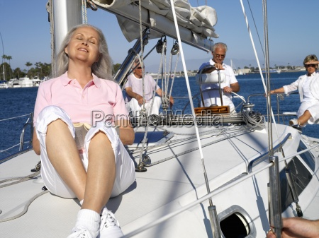 senior couple with friends on yacht