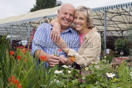 senior couple in nursery smiling portrait