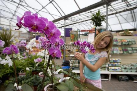 girl 7 9 in greenhouse garden