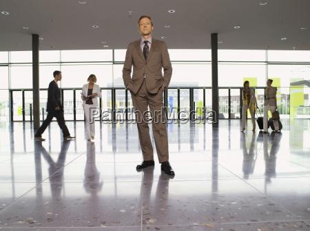 businessman posing in building lobby