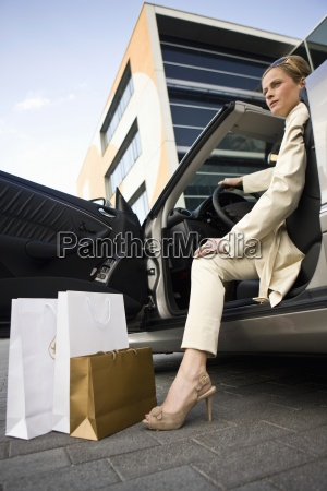 mature adult woman with shopping bags