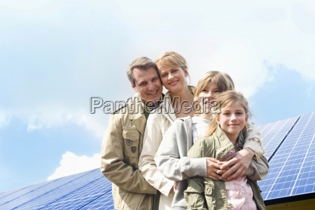 family posing together in front of