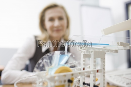 a businesswoman looking at a model