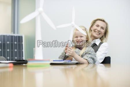 a businesswoman and young girl holding